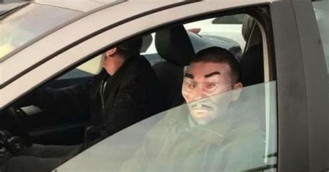 Masked carjackers pictured fleeing after they were tackled